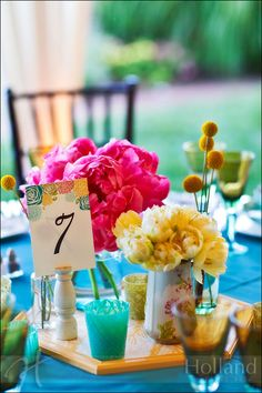 Love these bright flowers and table numbers