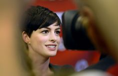 "Anne Hathaway talks to the press as she attends the Sundance premier of the movie ""Song One."" (Steve Griffin 