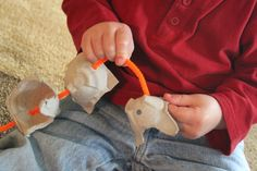 Thread pipe cleaners through egg cartons for fine motor