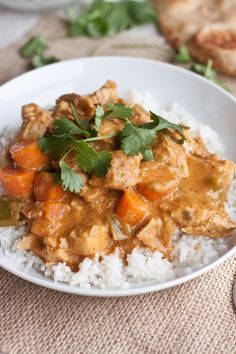 "Slow Cooker Coconut Curry Chicken - Making a curry at home sounds difficult, but this dish only calls for three ""exotic"" ingredients — coconut milk, curry powder, and garam masala spice mix — and all of them can be found at most grocery stores. Serve this flavorful dinner with a side of brown rice or Indian naan bread."
