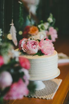 peony-topped cake, photo by Shari + Mike Photographers http://ruffledblog.com/black-rock-resort-wedding #weddingcake #cakes