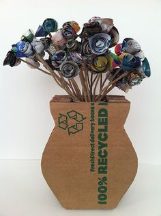 20 Creative and Useful DIY Cardboard Projects Here: Cardboard vase with paper made flowers craft, inspiration, mothers day, diy fashion, cardboard vase, fashion blogs, paper flowers, papers, recycled art