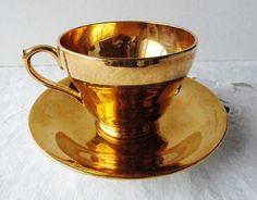 Golden tea cup and saucer