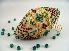 I'd love a beautiful beaded ornament or 2 like this.