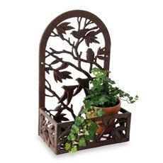 Wrought iron plant stands, hanging baskets, and sturdy ornate iron planters for indoor and outdoor plants.