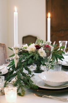A candlelit holiday table. candlelit holiday, table flowers, christmas centerpieces, low centerpieces, holiday centerpieces, christmas tables, christmas eve, winter tabl, holiday tables