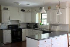 This is the same 'shape' of my kitchen. Could be done!   White Kitchen Cabinet Makeover featured on Remodelaholic.com