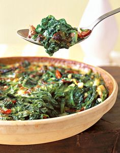 Creamed spinach substitutes milk for some heavy cream and gets zip from lemon juice and zest in this casserole. #healthy #recipes