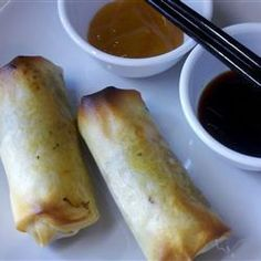 Baked Pork Spring Rolls | An exciting blend of pork, vegetables and spices is sealed inside wrappers, then baked until crisp. Delicious and crunchy without deep frying!