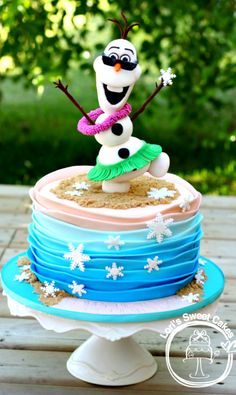 Olaf In Summer Cake ( Olaf is made of Rice Krispie Treats's and fondant. The ombre waves were inspired by a Royal Bakery.