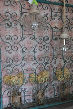 Paper wall hanging backs up iron scroll gate imported from Versailles, France.