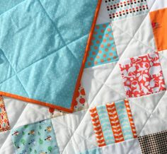 Quilted on the diagonal... also fabrics with dogs and helicopters. Cute for a little boy.
