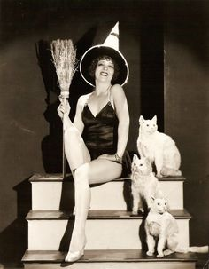 Clara Bow with three fake cats. #vintage #1920s #1930s #actresses #pinups #Halloween