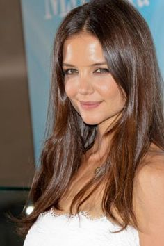 Katie Holmes flaunts a warm, brunette color that's also easy to maintain. Get your own perfect #hair #color to cover #grays at home here: http://www.haircolorforwomen.com/breakthrough-hair-color-system-your-salon-doesnt-want-you-to-know-about-p/