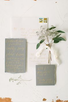 grey invitations with gold calligraphy, photo by Anne Brookshire http://ruffledblog.com/slate-gray-wedding-inspiration #weddinginvitations #stationery