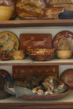 Redware gotta have at least a little in a colonial/early american/primitive home primit decor, red ware