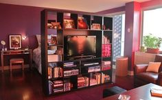 Awesome warm decor and TV in the center with ability to turn it around for the bedroom. #Small #Apartment and #Ideas