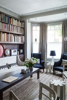 A London couple's disparate tastes and shared love of antiques creates a mélange of old and new, simplicity and texture in this renovated Vi...
