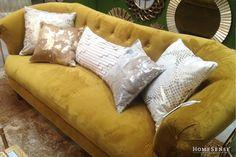 Dress down your statement gold tufted sofa with neutral cream and white cushions. #shiny #living #room #decor #couch #ideas / Donnez un côté plus décontracté à votre canapé capitonné doré grâce à des coussins de couleur neutres telles que crème et blanc. #brillant #salon #deco #canape #idees  Enter Contest: http://www.homesense.ca/en/pinterest-contest.asp   Participer: http://www.HomeSense.ca/HomeSenseStyleFr  #HomeSenseStyle