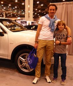 Jim Wurzburger and son Jakob at the Houston Auto Show. Jim is wearing his IWC Aquatimer Chronograph, and Jakob is wearing an original model Tag Heuer Formula One from the early 90′s, his Dad's watch in college.