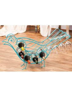 Blue Bird Wine Rack for $79.00 from WineRacks.com  Dimensions: 34.75w x 7.5d x 18h Capacity: 5 bottles  This bright metal wine rack will store both your wine and some of your stemware.  Sure to be a conversation piece, bring the blue bird of happiness into your home.