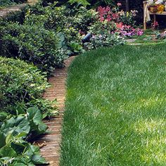 Brick Mowing Strip    Use flat edgings that are flush with the ground to make mowing easier. If you choose brick, as shown here, use paver edging strips, available at home stores, to hold it in place.