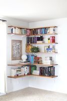Love this corner shelving for over a desk.