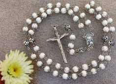 Floral Rosary ~ rosary beads made from flower petals in bouquet.