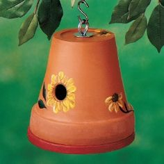 Attract birds to your yard with a DIY birdhouse made from a terra cotta pot embellished with painted sunflowers!