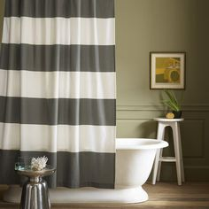 Olive wall and striped shower curtain