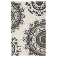 Showcasing a medallion motif in ivory, this hand-hooked wool rug effortlessly anchors your dining table or living room seating group.  ...
