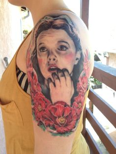 Dorothy from Wizard of Oz portrait tattoo with poppies