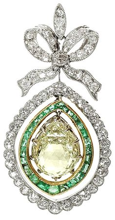 A belle époque emerald and diamond pendant/necklace, circa 1905 The delicate millegrain-set old brilliant and single-cut diamond bow surmount, suspending an articulated drop comprising a pear-shaped briolette diamond, weighing 3.86 carats, within a double border of calibré-cut emeralds and old brilliant and single-cut diamonds, mounted in platinum and yellow gold, later chain, pendant length 4.3cm, fitted case by Wales & McCulloch Ltd, 20 Ludgate Hill and 56 Cheapside, London