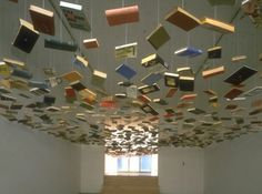 Tons of Book Display Ideas: Suspend them from the ceiling for the most epic mobile ever.