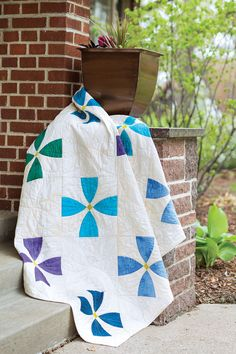 This #quilt was designed for Easy Quilts readers to make use of the new snowball die for the #AccuQuilt Go! If you're lucky enough to have this #cutting #system, you'll be able to cut all the pieces in no time at all. Digital pattern and quilt kit available! Viola Blossoms can be found in Easy Quilts Fall '14.