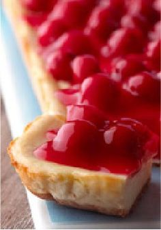 PHILADELPHIA New York Cheesecake Bars — New York may be the Big Apple, but when it comes to the city's iconic cheesecake, cherries rule the day. True to its heritage, the filling in this recipe is super-dense and rich.