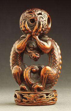 Japan Dragon Seal, 18th century Netsuke, Wood. LACMA
