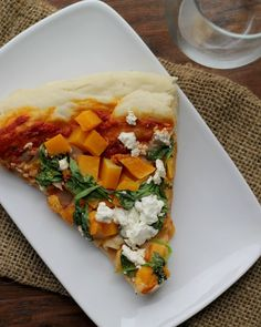 This butternut squash, spinach and feta pizza will be a major hit at your next fall pizza party!