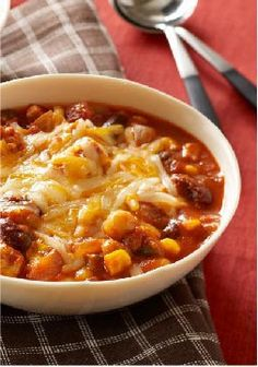 Slow-Cooker Chunky Chicken Chili -- This chicken thigh chili healthy living recipe fits into your smart eating plan, is slow-cooker convenient and tastes amazing. Simply put, it's a winner on every count.