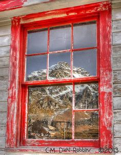 Hatcher's' Pass in Alaska... reflection of Independence Mine shot off one of the windows on a bunk house. Freeze Frame Photography