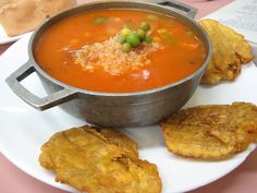 asopao de pollo con tostones (chicken-with-rice soup, Puerto Rican style, and fried plantains)