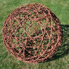I like to call them tetanus balls! You have to be very careful when you roll 'em up. Fun to put a plant of ivy inside or to decorate with white Christmas lights.
