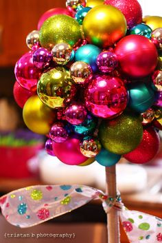 Ornament topiary.. Would be cute as a centerpiece for a Christmas party.