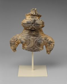 Ceramics dogu figure  16.5 cm high (6 1/2 inch.)   Japanese, Jomon Period, 1000 - 300 BC.   Source: Metropolitan Museum