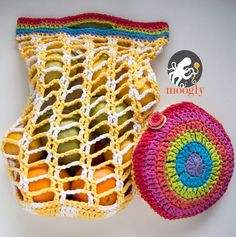 Rainbow Pocket Market Bag - folds up to go anywhere! Free crochet pattern with 2 different handle styles to choose from!