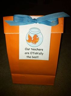 I made these last year (on behalf of the PTA) for all of our teachers during Teacher Appreciation Week.  I put a bag of Goldfish crackers inside each one.