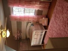 Pink, white and gray nursery gray walls... white furniture...
