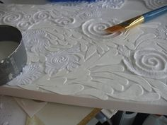 Technique: pressed paper pulp and cut paper pieces on canvas