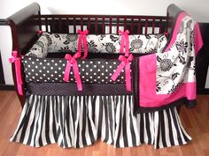 Tia Baby Bedding  Included in this set is the bumper, blanket, and crib skirt.  There is lots of detail in this custom set including  soft black minky, grosgrain ribbons, black and white stripes, polka dots, and flowers.