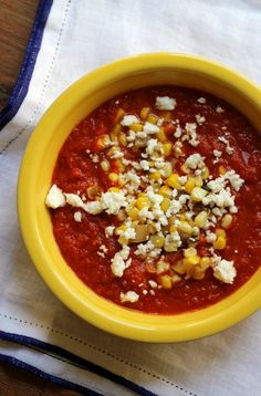 The rich flavors of roasted vegetables are paired with a sweet corn and salty feta topping in this velvety roasted red pepper soup.